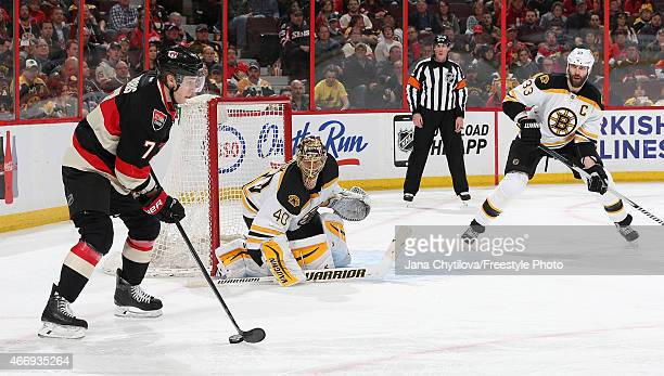 Tuukka Rask and Zdeno Chara of the Boston Bruins defend the net against a puck carrying Kyle Turris of the Ottawa Senators in the second period at...