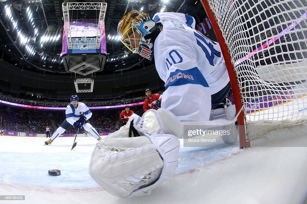 <a gi-track='captionPersonalityLinkClicked' href=/galleries/search?phrase=Tuukka+Rask&family=editorial&specificpeople=716723 ng-click='$event.stopPropagation()'>Tuukka Rask</a> #40 of Finland makes a save against Jamie Benn #22 of Canada in the first period during the Men's Ice Hockey Preliminary Round Group B game on day nine of the Sochi 2014 Winter Olympics at Bolshoy Ice Dome on February 16, 2014 in Sochi, Russia.