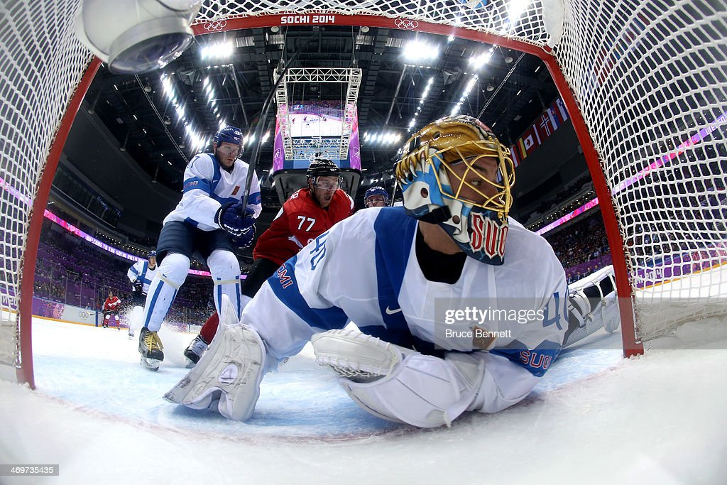 Tuukka Rask #40 of Finland makes a save against Jamie Benn #22 of Canada in the first period during the Men's Ice Hockey Preliminary Round Group B game on day nine of the Sochi 2014 Winter Olympics at Bolshoy Ice Dome on February 16, 2014 in Sochi, Russia.