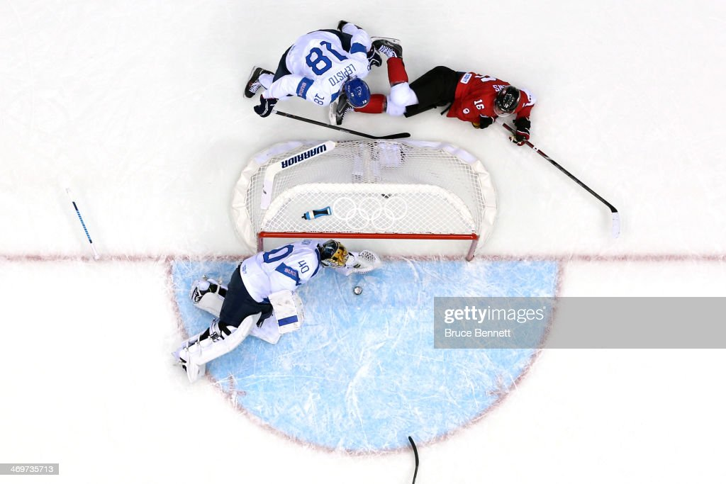 Tuukka Rask #40 of Finland makes a save against Jonathan Toews #16 of Canada in the first period during the Men's Ice Hockey Preliminary Round Group B game on day nine of the Sochi 2014 Winter Olympics at Bolshoy Ice Dome on February 16, 2014 in Sochi, Russia.