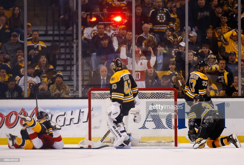 Tuukka Rask #40 of the Boston Bruins and his teammates react after being scored on in the third period against the Detroit Red Wings in Game One of the First Round of the 2014 NHL Stanley Cup Playoffs at TD Garden on April 18, 2014 in Boston, Massachusetts.