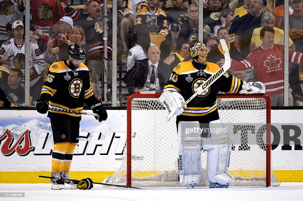 Tuukka Rask #40 of the Boston Bruins and Johnny Boychuk #55 of the Boston Bruins look on after the Chicago Blackhawks scored in the third period in Game Six of the 2013 NHL Stanley Cup Final at TD Garden on June 24, 2013 in Boston, Massachusetts.