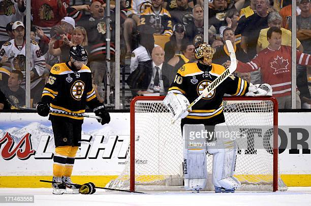 Tuukka Rask of the Boston Bruins and Johnny Boychuk of the Boston Bruins look on after the Chicago Blackhawks scored in the third period in Game Six...