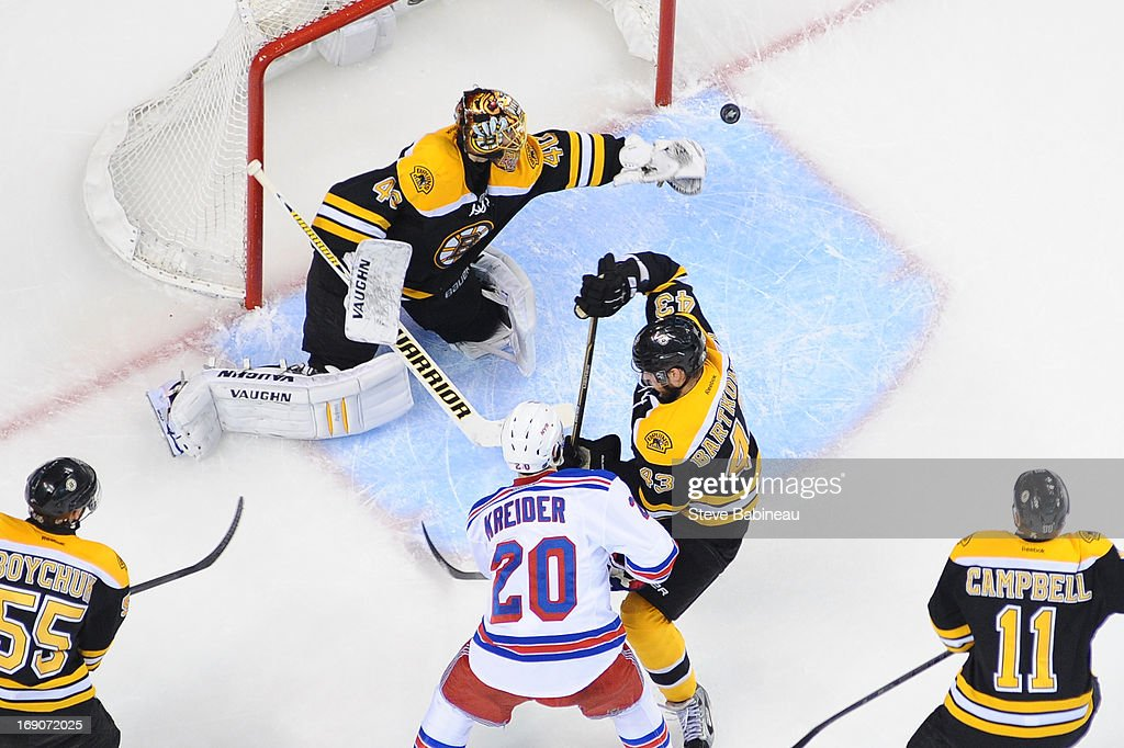 <a gi-track='captionPersonalityLinkClicked' href=/galleries/search?phrase=Tuukka+Rask&family=editorial&specificpeople=716723 ng-click='$event.stopPropagation()'>Tuukka Rask</a> #40 of the Boston Bruins bats the puck out of the area against the New York Rangers in Game Two of the Eastern Conference Semifinals during the 2013 NHL Stanley Cup Playoffs at TD Garden on May 19, 2013 in Boston, Massachusetts.