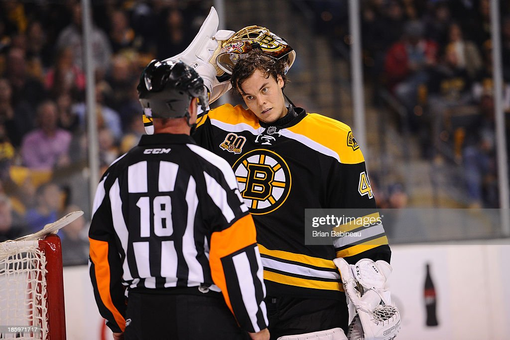<a gi-track='captionPersonalityLinkClicked' href=/galleries/search?phrase=Tuukka+Rask&family=editorial&specificpeople=716723 ng-click='$event.stopPropagation()'>Tuukka Rask</a> #40 of the Boston Bruins chats with a referee during a time out against the New Jersey Devils at the TD Garden on October 26, 2013 in Boston, Massachusetts.
