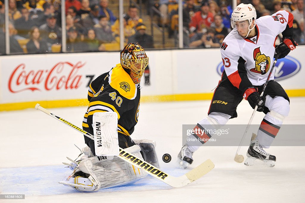<a gi-track='captionPersonalityLinkClicked' href=/galleries/search?phrase=Tuukka+Rask&family=editorial&specificpeople=716723 ng-click='$event.stopPropagation()'>Tuukka Rask</a> #40 of the Boston Bruins deflects the puck against the Ottawa Senators at the TD Garden on February 28, 2013 in Boston, Massachusetts.