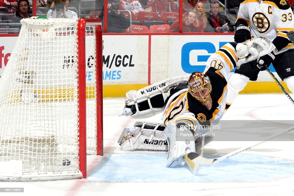 <a gi-track='captionPersonalityLinkClicked' href=/galleries/search?phrase=Tuukka+Rask&family=editorial&specificpeople=716723 ng-click='$event.stopPropagation()'>Tuukka Rask</a> #40 of the Boston Bruins dives but cant make the save as Mike Ribeiro of the Washington Capitals (not pictured) scores in the second period of an NHL game at Verizon Center on March 5, 2013 in Washington, DC.