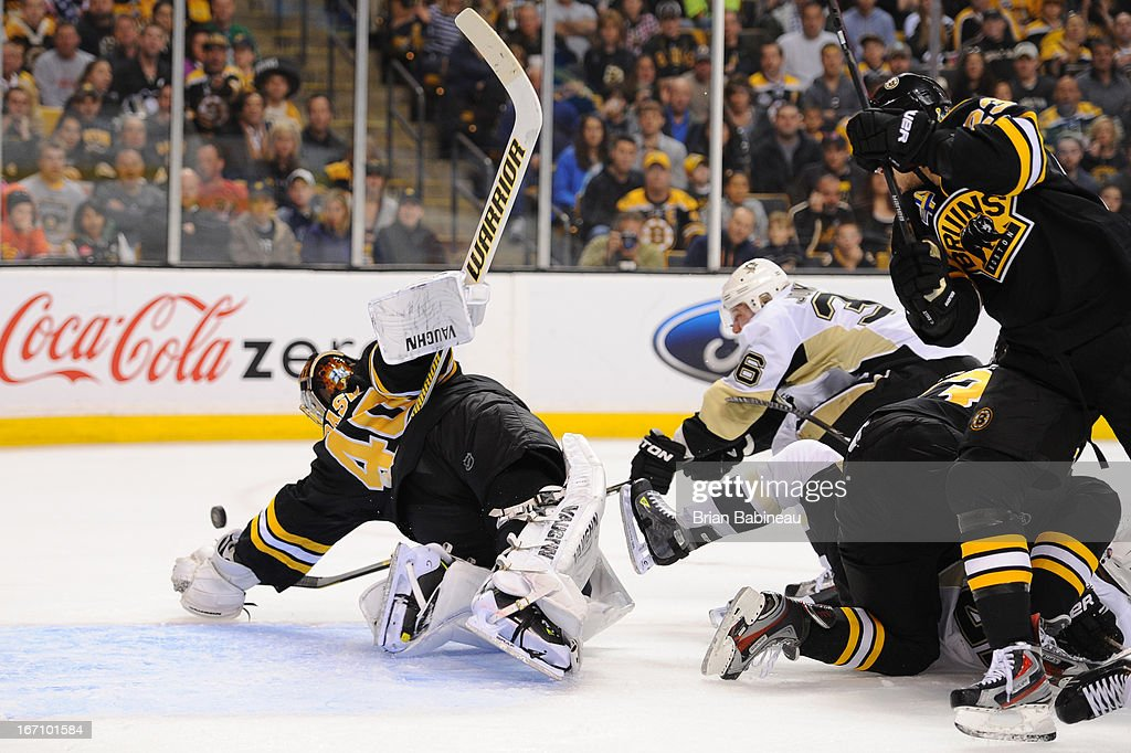 Tuukka Rask #40 of the Boston Bruins dives for the puck against the Pittsburgh Penguins at the TD Garden on April 20, 2013 in Boston, Massachusetts.
