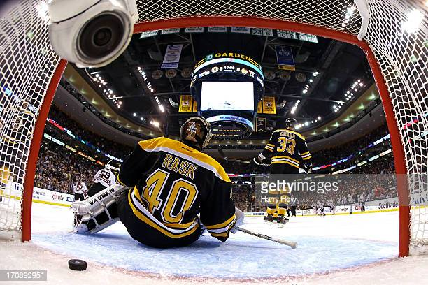 Tuukka Rask of the Boston Bruins fails to save the game winning goal by Brent Seabrook of the Chicago Blackhawks in overtime in Game Four of the 2013...
