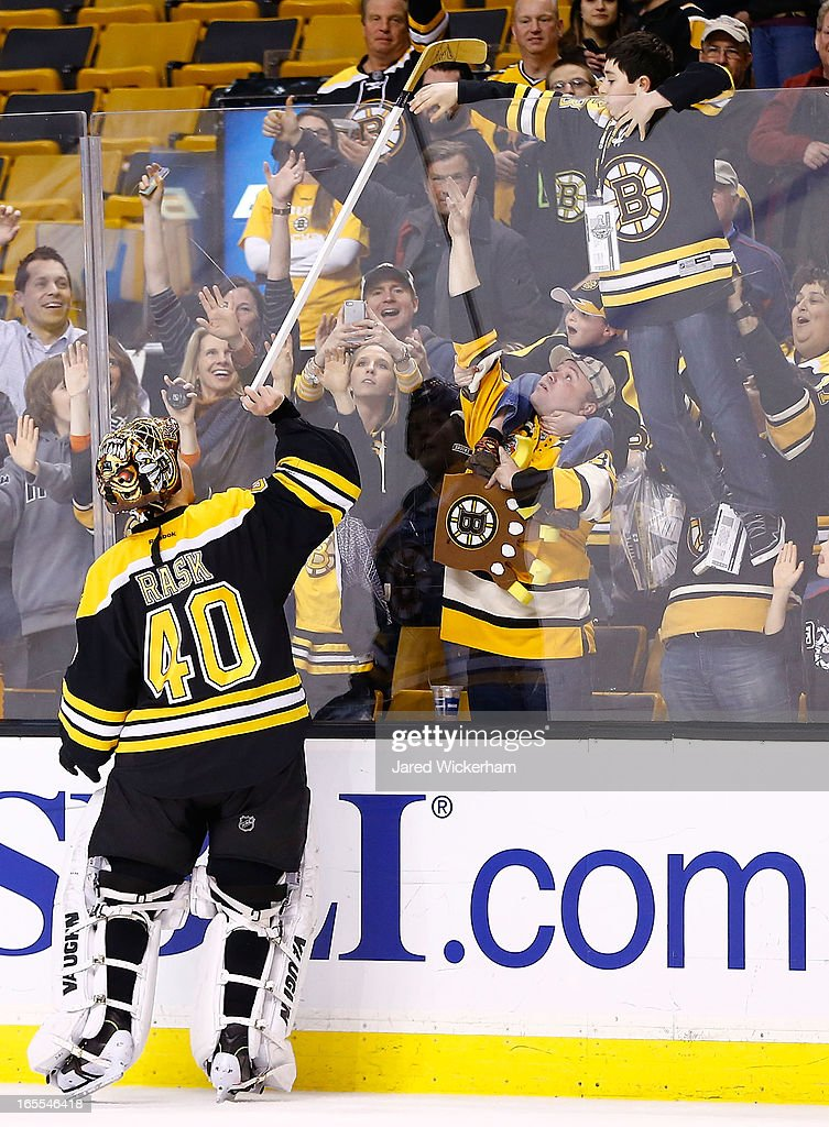 <a gi-track='captionPersonalityLinkClicked' href=/galleries/search?phrase=Tuukka+Rask&family=editorial&specificpeople=716723 ng-click='$event.stopPropagation()'>Tuukka Rask</a> #40 of the Boston Bruins hands his stick over the boards to a fan after being named the #1 star in their 1-0 shutout win against the New Jersey Devils during the game on April 2, 2013 at TD Garden in Boston, Massachusetts.