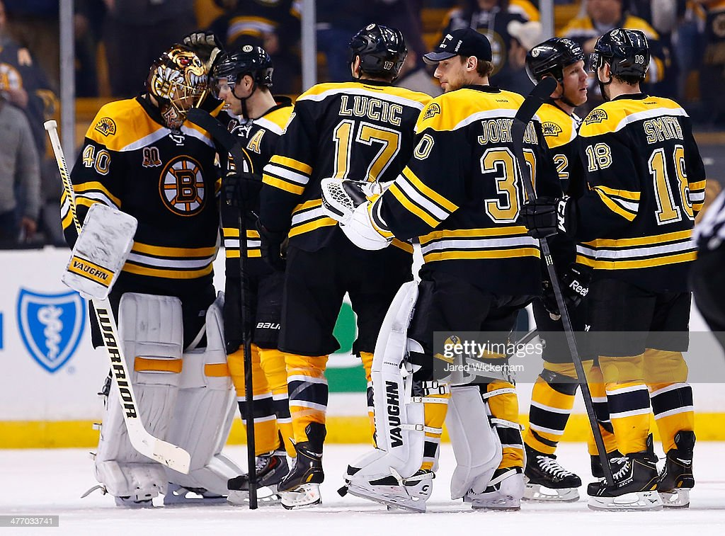 <a gi-track='captionPersonalityLinkClicked' href=/galleries/search?phrase=Tuukka+Rask&family=editorial&specificpeople=716723 ng-click='$event.stopPropagation()'>Tuukka Rask</a> #40 of the Boston Bruins is congratulated by his teammates following their 3-0 win against the Washington Capitals during the game at TD Garden on March 6, 2014 in Boston, Massachusetts.
