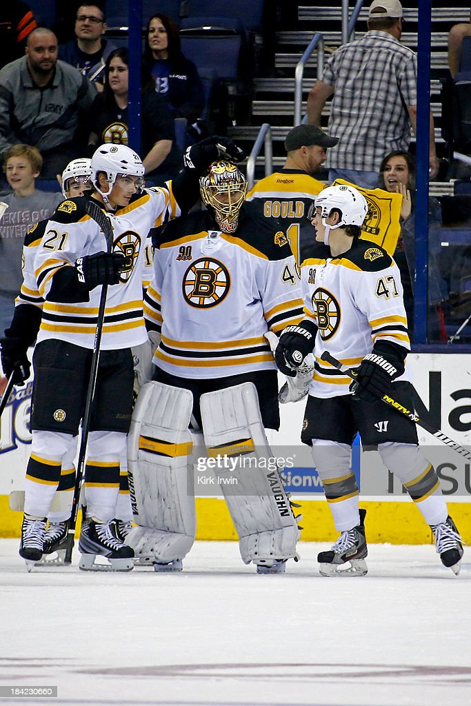 <a gi-track='captionPersonalityLinkClicked' href=/galleries/search?phrase=Tuukka+Rask&family=editorial&specificpeople=716723 ng-click='$event.stopPropagation()'>Tuukka Rask</a> #40 of the Boston Bruins is congratulated by <a gi-track='captionPersonalityLinkClicked' href=/galleries/search?phrase=Loui+Eriksson&family=editorial&specificpeople=2235241 ng-click='$event.stopPropagation()'>Loui Eriksson</a> #21 of the Boston Bruins and <a gi-track='captionPersonalityLinkClicked' href=/galleries/search?phrase=Torey+Krug&family=editorial&specificpeople=6670036 ng-click='$event.stopPropagation()'>Torey Krug</a> #47 of the Boston Bruins after defeating the Columbus Blue Jackets 3-1 on October 12, 2013 at Nationwide Arena in Columbus, Ohio.