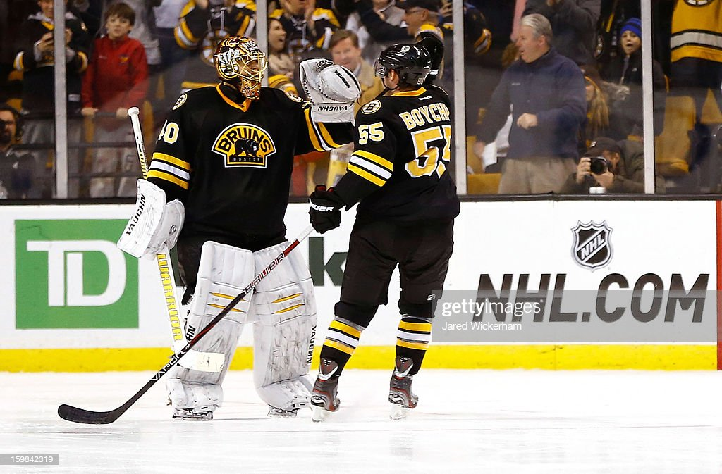 Tuukka Rask #40 of the Boston Bruins is congratulated by teammate Johnny Boychuk #55 following their shootout win against the Winnipeg Jets during the game on January 21, 2013 at TD Garden in Boston, Massachusetts.