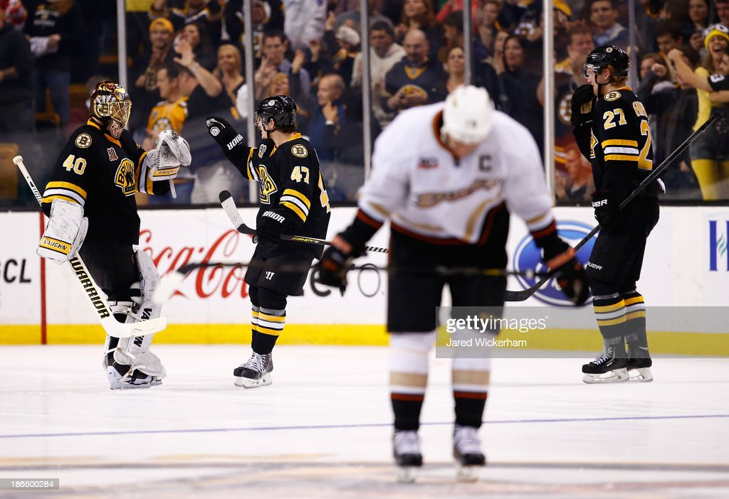 Tuukka Rask #40 of the Boston Bruins is congratulated by teammate Torey Krug #47 of the Boston Bruins after their 3-2 win in an overtime shootout against the Anaheim Ducks at TD Garden on October 31, 2013 in Boston, Massachusetts.