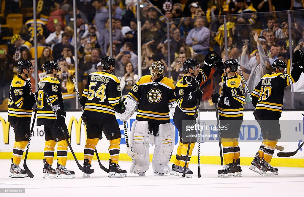 <a gi-track='captionPersonalityLinkClicked' href=/galleries/search?phrase=Tuukka+Rask&family=editorial&specificpeople=716723 ng-click='$event.stopPropagation()'>Tuukka Rask</a> #40 of the Boston Bruins is congratulated by teammates following their 4-1 win against the Toronto Maple Leafs in Game One of the Eastern Conference Quarterfinals during the 2013 NHL Stanley Cup Playoffs on May 1, 2013 at TD Garden in Boston, Massachusetts.