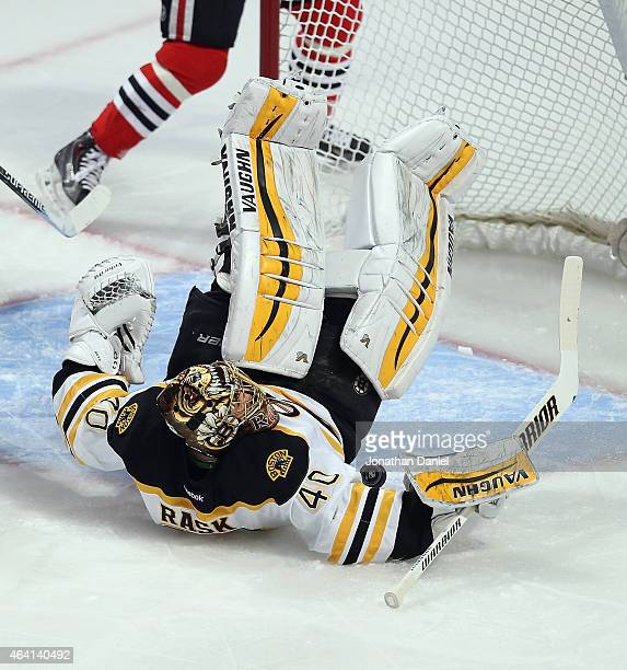 Tuukka Rask of the Boston Bruins lands on his back while making a save against the Chicago Blackhawks at the United Center on February 22 2015 in...