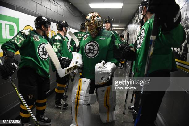 Tuukka Rask of the Boston Bruins leads the team out for warm ups before the game against the Philadelphia Flyers at the TD Garden on March 11 2017 in...