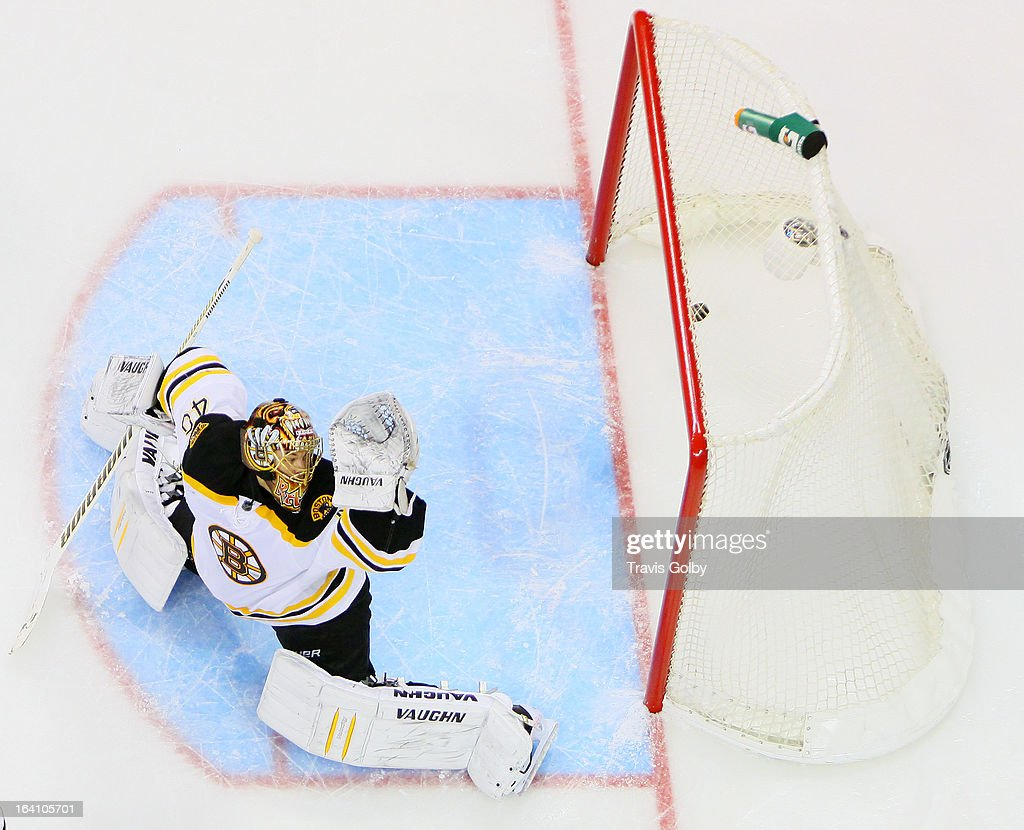<a gi-track='captionPersonalityLinkClicked' href=/galleries/search?phrase=Tuukka+Rask&family=editorial&specificpeople=716723 ng-click='$event.stopPropagation()'>Tuukka Rask</a> #40 of the Boston Bruins looks behind him as a shot by Blake Wheeler #26 of the Winnipeg Jets (not shown) eludes his glove and hits the back of the net for a third period goal at the MTS Centre on March 19, 2013 in Winnipeg, Manitoba, Canada.