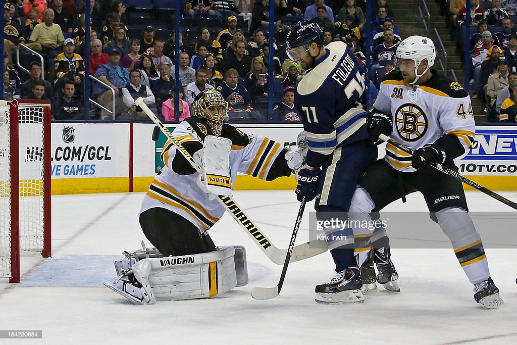 <a gi-track='captionPersonalityLinkClicked' href=/galleries/search?phrase=Tuukka+Rask&family=editorial&specificpeople=716723 ng-click='$event.stopPropagation()'>Tuukka Rask</a> #40 of the Boston Bruins makes a blocker save as <a gi-track='captionPersonalityLinkClicked' href=/galleries/search?phrase=Dennis+Seidenberg&family=editorial&specificpeople=204616 ng-click='$event.stopPropagation()'>Dennis Seidenberg</a> #44 of the Boston Bruins attempts to keep <a gi-track='captionPersonalityLinkClicked' href=/galleries/search?phrase=Nick+Foligno&family=editorial&specificpeople=537821 ng-click='$event.stopPropagation()'>Nick Foligno</a> #71 of the Columbus Blue Jackets from getting to the rebound during the second period on October 12, 2013 at Nationwide Arena in Columbus, Ohio. Boston defeated Columbus 3-1.
