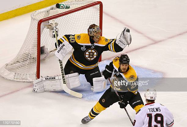 Tuukka Rask of the Boston Bruins makes a glove save in the first period against the Chicago Blackhawks in Game Three of the 2013 NHL Stanley Cup...
