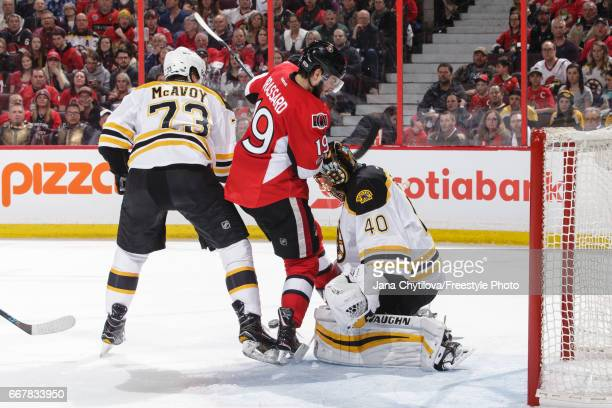 Tuukka Rask of the Boston Bruins makes a pad save against Derick Brassard of the Ottawa Senators as Charlie McAvoy of the Boston Bruins defends the...
