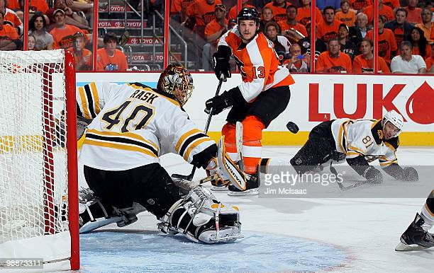 Tuukka Rask of the Boston Bruins makes a save against Daniel Carcillo of the Philadelphia Flyers in Game Three of the Eastern Conference Semifinals...