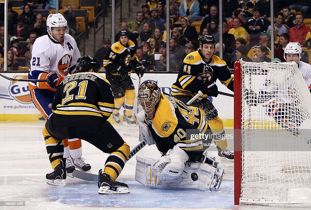 <a gi-track='captionPersonalityLinkClicked' href=/galleries/search?phrase=Tuukka+Rask&family=editorial&specificpeople=716723 ng-click='$event.stopPropagation()'>Tuukka Rask</a> #40 of the Boston Bruins makes a save against <a gi-track='captionPersonalityLinkClicked' href=/galleries/search?phrase=Kyle+Okposo&family=editorial&specificpeople=540469 ng-click='$event.stopPropagation()'>Kyle Okposo</a> #21 of the New York Islanders at the TD Garden on April 11, 2013 in Boston, Massachusetts. The Islanders defeated the Bruins 2-1.