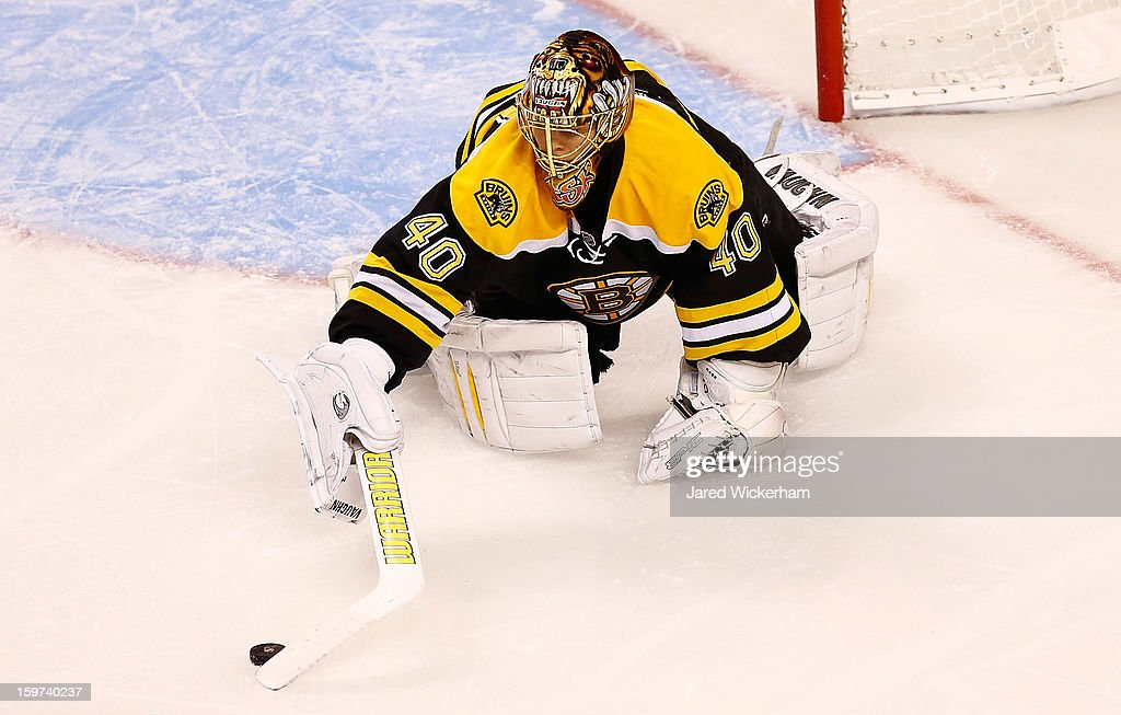<a gi-track='captionPersonalityLinkClicked' href=/galleries/search?phrase=Tuukka+Rask&family=editorial&specificpeople=716723 ng-click='$event.stopPropagation()'>Tuukka Rask</a> #40 of the Boston Bruins makes a save against the New York Rangers in the second period during the season opener game on January 19, 2013 at TD Garden in Boston, Massachusetts.