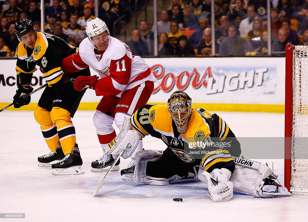 <a gi-track='captionPersonalityLinkClicked' href=/galleries/search?phrase=Tuukka+Rask&family=editorial&specificpeople=716723 ng-click='$event.stopPropagation()'>Tuukka Rask</a> #40 of the Boston Bruins makes a save in front of <a gi-track='captionPersonalityLinkClicked' href=/galleries/search?phrase=Daniel+Alfredsson&family=editorial&specificpeople=201853 ng-click='$event.stopPropagation()'>Daniel Alfredsson</a> #11 of the Detroit Red Wings in the second period in Game One of the First Round of the 2014 NHL Stanley Cup Playoffs at TD Garden on April 18, 2014 in Boston, Massachusetts.