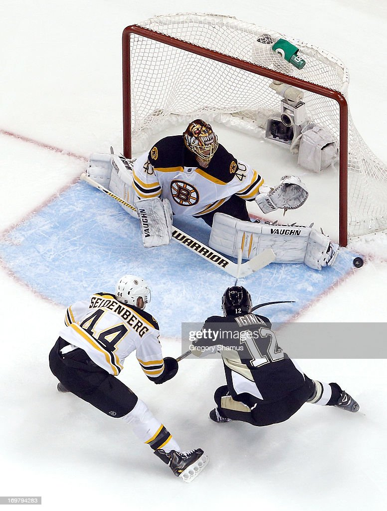 <a gi-track='captionPersonalityLinkClicked' href=/galleries/search?phrase=Tuukka+Rask&family=editorial&specificpeople=716723 ng-click='$event.stopPropagation()'>Tuukka Rask</a> #40 of the Boston Bruins makes a save in front of <a gi-track='captionPersonalityLinkClicked' href=/galleries/search?phrase=Dennis+Seidenberg&family=editorial&specificpeople=204616 ng-click='$event.stopPropagation()'>Dennis Seidenberg</a> #44 and <a gi-track='captionPersonalityLinkClicked' href=/galleries/search?phrase=Jarome+Iginla&family=editorial&specificpeople=201792 ng-click='$event.stopPropagation()'>Jarome Iginla</a> #12 of the Pittsburgh Penguins in Game One of the Eastern Conference Final during the 2013 NHL Stanley Cup Playoffs at Consol Energy Center on June 1, 2013 in Pittsburgh, Pennsylvania.