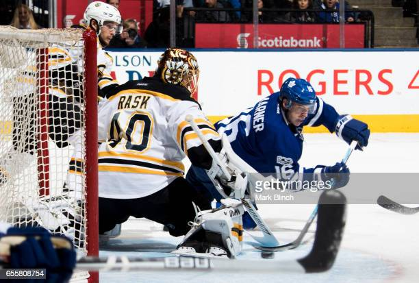 Tuukka Rask of the Boston Bruins makes a save on Mitch Marner of the Toronto Maple Leafs during the first period at the Air Canada Centre on March 20...