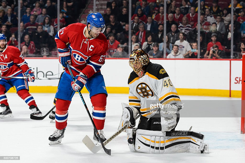Tuukka Rask #40 of the Boston Bruins makes a save with Max Pacioretty #67 of the Montreal Canadiens standing in front during the NHL game at the Bell Centre on December 9, 2015 in Montreal, Quebec, Canada.