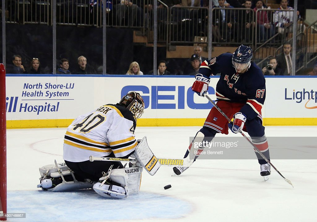 <a gi-track='captionPersonalityLinkClicked' href=/galleries/search?phrase=Tuukka+Rask&family=editorial&specificpeople=716723 ng-click='$event.stopPropagation()'>Tuukka Rask</a> #40 of the Boston Bruins makes the save on <a gi-track='captionPersonalityLinkClicked' href=/galleries/search?phrase=Benoit+Pouliot&family=editorial&specificpeople=879830 ng-click='$event.stopPropagation()'>Benoit Pouliot</a> #67 of the New York Rangers at Madison Square Garden on November 19, 2013 in New York City. The Bruins defeated the Rangers 2-1.