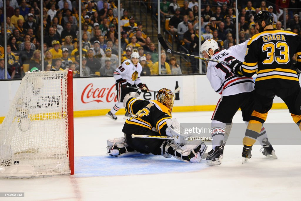 Tuukka Rask #40 of the Boston Bruins misses the puck to let in a goal in overtime shot by Brent Seabrook of the Chicago Blackhawks in Game Four of the Stanley Cup Final at TD Garden on June 19, 2013 in Boston, Massachusetts.
