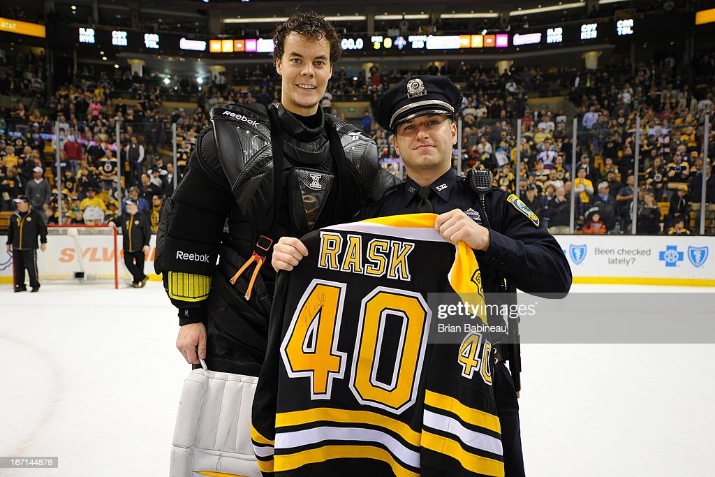 <a gi-track='captionPersonalityLinkClicked' href=/galleries/search?phrase=Tuukka+Rask&family=editorial&specificpeople=716723 ng-click='$event.stopPropagation()'>Tuukka Rask</a> #40 of the Boston Bruins poses with one of the first responders from the Boston Marathon tragedy after the game against the Florida Panthers at the TD Garden on April 21, 2013 in Boston, Massachusetts.