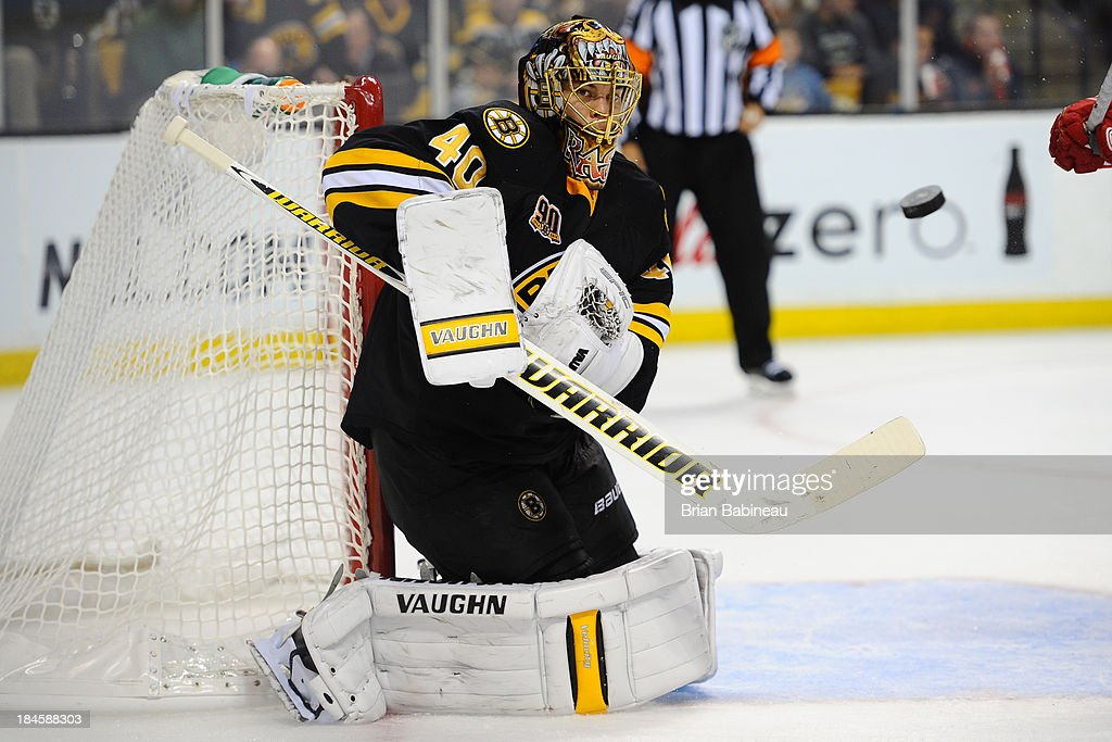 <a gi-track='captionPersonalityLinkClicked' href=/galleries/search?phrase=Tuukka+Rask&family=editorial&specificpeople=716723 ng-click='$event.stopPropagation()'>Tuukka Rask</a> #40 of the Boston Bruins prepares for the incoming puck against the Detroit Red Wings at the TD Garden on October 14, 2013 in Boston, Massachusetts.