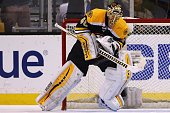 Tuukka Rask of the Boston Bruins reacts after saving a shot by Nazem Kadri of the Toronto Maple Leafs winning the game for the Boston Bruins during a...