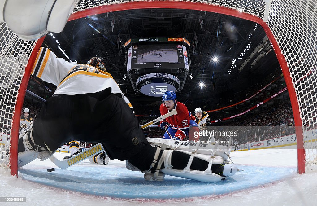 Tuukka Rask of the Boston Bruins stops a shot from David Desharnais of the Montreal Canadiens during the NHL game on February 6 2013 at the Bell...