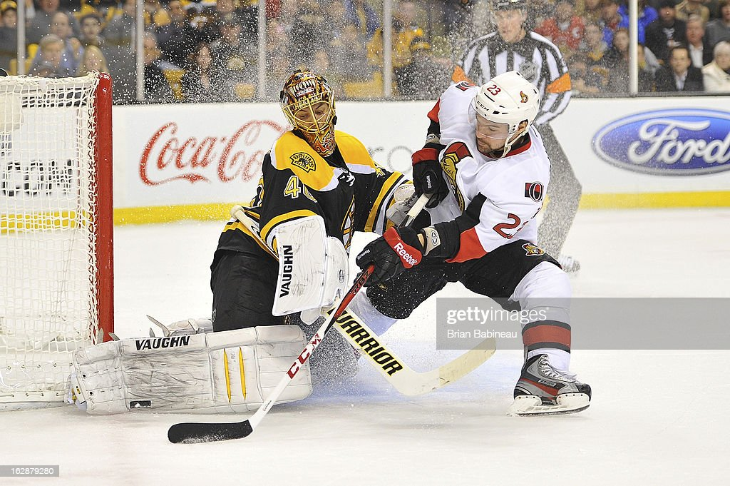 <a gi-track='captionPersonalityLinkClicked' href=/galleries/search?phrase=Tuukka+Rask&family=editorial&specificpeople=716723 ng-click='$event.stopPropagation()'>Tuukka Rask</a> #40 of the Boston Bruins stops the puck against Kaspars Daugavins #23 of the Ottawa Senators at the TD Garden on February 28, 2013 in Boston, Massachusetts.
