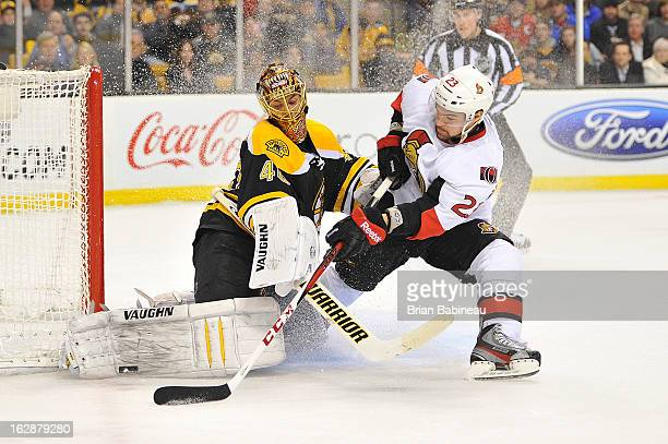 Tuukka Rask of the Boston Bruins stops the puck against Kaspars Daugavins of the Ottawa Senators at the TD Garden on February 28 2013 in Boston...