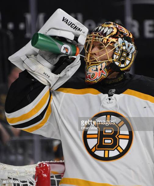 Tuukka Rask of the Boston Bruins takes a drink during a break in the team's game against the Vegas Golden Knights at TMobile Arena on October 15 2017...