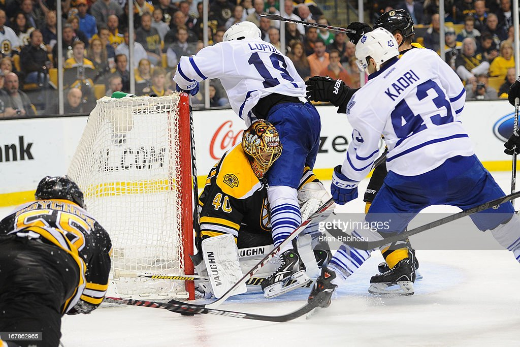 Tuukka Rask #40 of the Boston Bruins tries to fight for the puck against the Toronto Maple Leafs in Game One of the Eastern Conference Quarterfinals during the 2013 NHL Stanley Cup Playoffs at TD Garden on May 1, 2013 in Boston, Massachusetts.