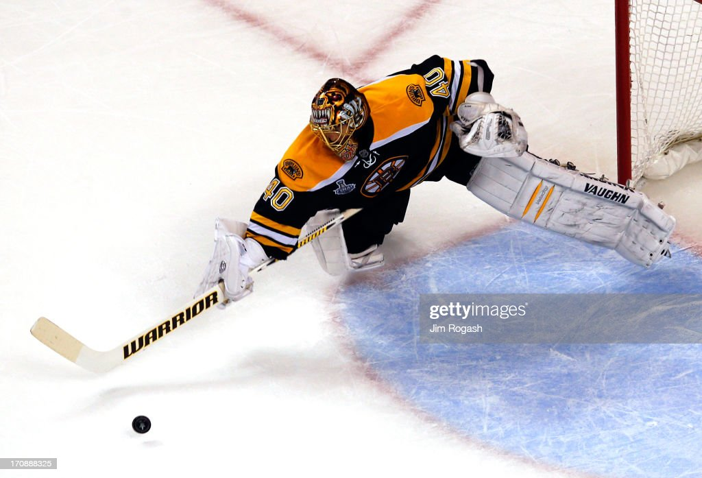 Tuukka Rask #40 of the Boston Bruins tries to make a save against the Chicago Blackhawks in Game Four of the 2013 NHL Stanley Cup Final at TD Garden on June 19, 2013 in Boston, Massachusetts.