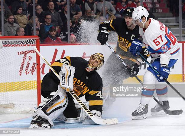 Tuukka Rask stops a shot by Max Pacioretty of the Boston Bruinsof the Montreal Canadiens in the NHL game at the Bell Centre on January 19 2016 in...