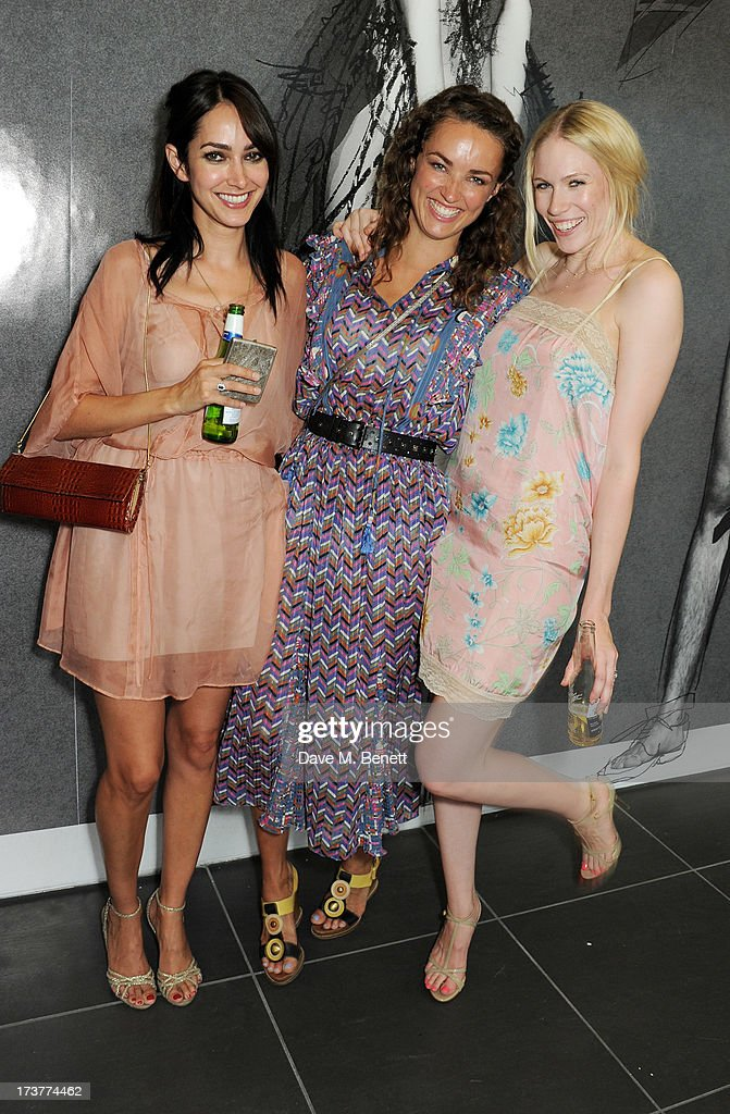 Tuuli Shipster (R) and guests attend the French Connection x Rankin 'The Full Service' #SketchToStore campaign launch at Rankin Studios on July 17, 2013 in London, England.