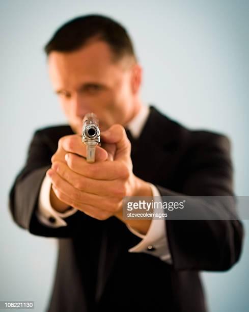 Mespilia hombre y la pistola