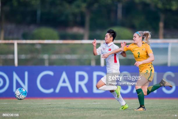 Tuyet Ngan of Vietnam fights for the ball with Ellie Carpenter of Australia during their AFC U19 Women's Championship 2017 Group Stage match between...
