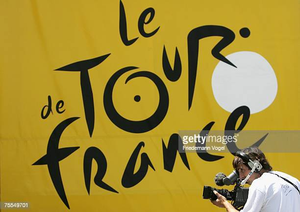 A tv camera man is seen in front of a Tour de France banner during stage eleven of the Tour de France from Marseille to Montpellier on July 19 2007...