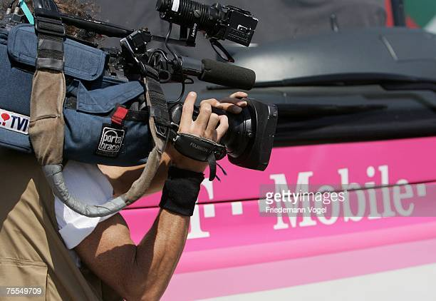 A tv camera man is seen in front of the TMobile bus during stage eleven of the Tour de France from Marseille to Montpellier on July 19 2007 in...