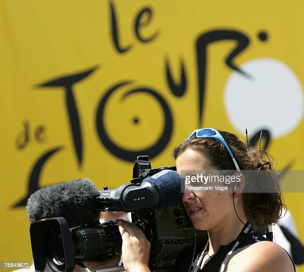 A tv camera man is seen n front of a Tour de France banner during stage eleven of the Tour de France from Marseille to Montpellier on July 19 2007 in...